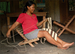 Ayda Velasquez weaving a bag from chambira fiber at Brillo Nuevo - Photo by Campbell Plowden/CACE