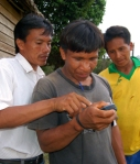 Rolando Panduro teaching Bora woodsmen how to use a GPS - Photo by Campbell Plowden/CACE