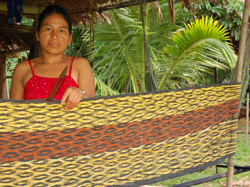 Amazon artisan Felicita Butuna Chichaco from Brillo Nuevo, Peru with a chambira palm fiber hammock - Photo by Campbell Plowden/CACE