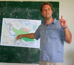 Michael Gilmore pointing to proposed road through Maijuna traditional land - Photo by Campbell Plowden/CACE