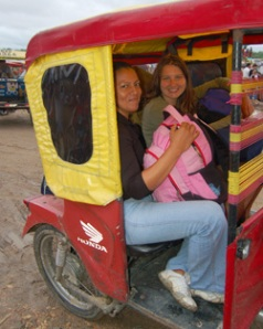 Natalya Stanko and Yully Rojas in motocar in Iquitos - Photo by Campbell Plowden/CACE