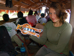 Natalya Stanko with Penn State Nittany Lion mascot in lancha on Sucusari River, Peru - Photo by Campbell Plowden/CACE