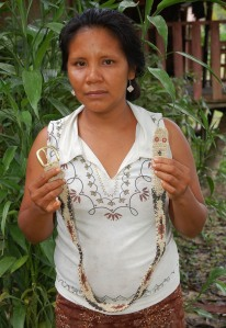 Brillo Nuevo artisan Amalia Arirama with white boa chambira belt. Photo by Campbell Plowden/Center for Amazon Community Ecology