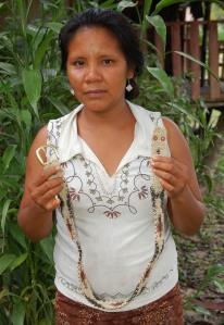 Brillo Nuevo artisan Amalia Arirama with white boa chambira belt. Photo by Campbell Plowden/Center for Amazon Community Ecology