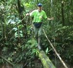 Campbell Plowden crossing stream near Brillo Nuevo. Photo by Natalya Stanko/Center for Amazon Community Ecology