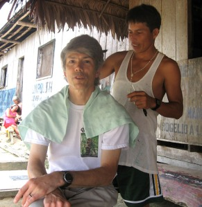 Campbell Plowden getting haircut at Jenaro Herrera. Photo by Marissa Plowden/Center for Amazon Community Ecology