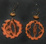 Earrings made from Huicungo palm seeds. Photo by Campbell Plowden/CACE
