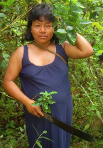 Ines Chichaco with huito leaves in her purma. Photo by Campbell Plowden/CACE