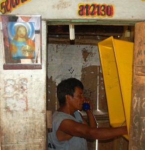 Jesus mirror by telephone in Brillo Nuevo. Photo by Campbell Plowden/Center for Amazon Community Ecology