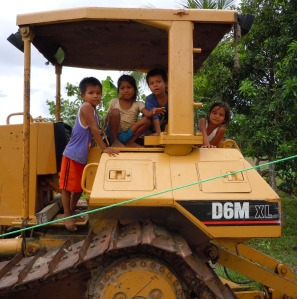 Huitoto children playing on tractor at Puca Urquillo. Photo by Campbell Plowden/CACE