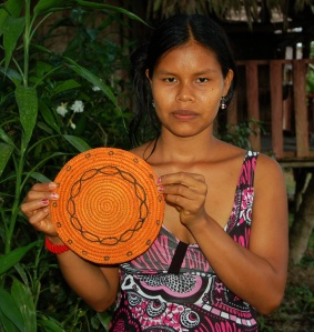 Brillo Nuevo artisan Maria with tapete. Photo by Campbell Plowden/CACE