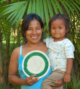 Brillo Nuevo artisan Monica Chichaco with daughter and tapete. Photo by Campbell Plowden/CACE