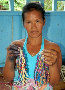 Nueva Esperanza artisan Mirtha Vasquez with chambira palm fiber bracelets. Photo by Campbell Plowden/Center for Amazon Community Ecology