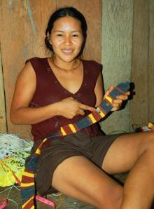 Alida Soria making Amazon guitar strap