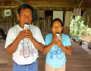 Aurelio and Marcelina playing balsa wood catfish flutes