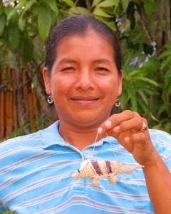 Huitoto artisan Cherly Flores with armadillo ornament at Puca Urquillo.  Photo by Campbell Plowden/CACE