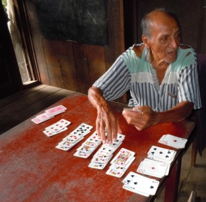 Don Jose playing solitaire. Photo by C. Plowden/CACE