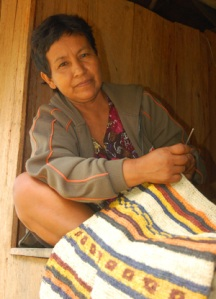 Gloria Vasquez weaving chambira bag. Photo by C. Plowden/CACE