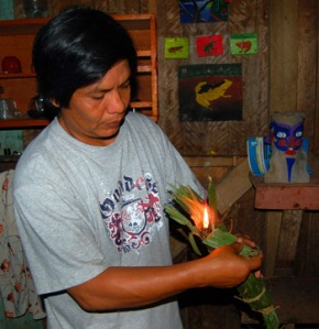 Hernan and copal torch at Brillo Nuevo in 2008. Photo by C. Plowden/CACE