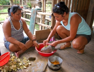 Grand Valley University student Katrina and Chino artisan grating huito fruit dye. Photo by C. Plowden/CACE