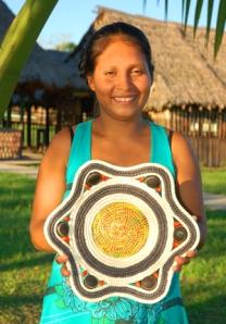 Chino artisan Madita displaying a chambira basket. Photo by C. Plowden/CACE