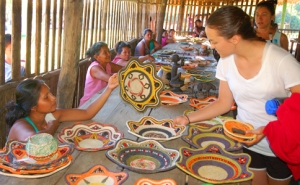 Chino artisan showing basket to Grand Valley University student. Photo by C. Plowden/CACE