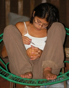 Marissa Plowden carving a coconut at Jenaro Herrera in 2006. Photo by C. Plowden/CACE