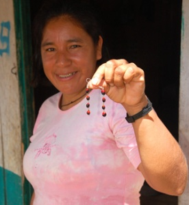 Jenaro Herrera artisan Neri with huayruru earrings. Photo by C. Plowden/CACE
