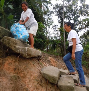 Yully Rojas and Ena Chichaco climbing stairs at Puca Uquillo