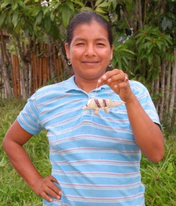 Huitoto native artisan Cherly Flores Ribeira with armadillo ornament in Puca Urquillo, Peru.  Photo by Campbell Plowden/Center for Amazon Community Ecology