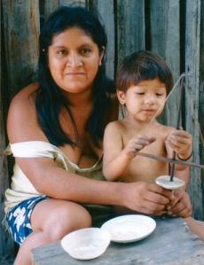 Lourdinha  Tembé and Luke Plowden with bow drill. © Photo by Campbell Plowden/Center for Amazon Community Ecology