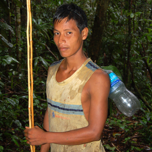 Maijuna young man from Nueva Vida with bottle and poles. Photo by C. Plowden/CACE