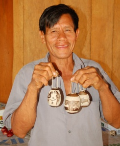 Bora native artisan Pedro with calabash Amazon wildlife ornamentsin Puca Urquillo. Photo by Campbell Plowden/Center for Amazon Community Ecology