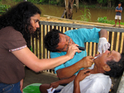 Project Amazonas dentist with patient. © Photo by Project Amazonas