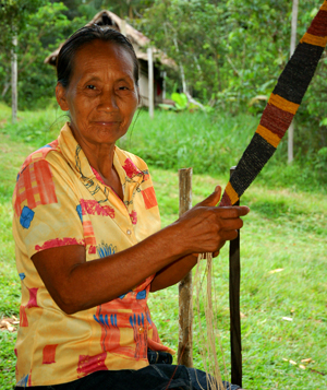Bora artisan weaving Amazon guitar strap. ©Photo by Campbell Plowden/Center for Amazon Community Ecology