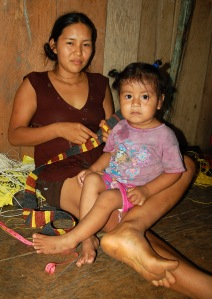 Alida Soria, Bora native artisan from Brillo Nuevo with daughter. Photo by Campbell Plowden/Center for Amazon Community Ecology