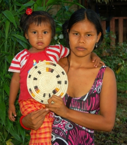 Maria Roque - Bora native artisan and baby from Brillo Nuevo with Amazon hot pad. Photo by Campbell Plowden/Center for Amazon Community Ecology