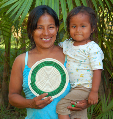 Monica Chichaco - Bora native artisan and baby from Brillo Nuevo with Amazon hot pad. Photo by Campbell Plowden/Center for Amazon Community Ecology