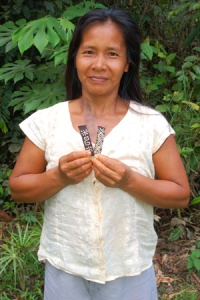 Bora native artisan Ania Ruiz with Amazon hair barrettes BF01A & BF09A.  Photo by Campbell Plowden/Center for Amazon Community Ecology