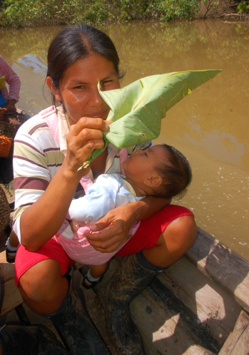 Dalila Arirama and baby on boat. Photo by Campbell Plowden/Center for Amazon Community Ecology