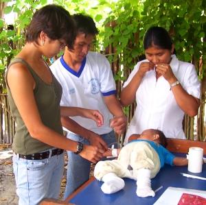 Marissa Plowden with baby at Jenaro Herrera clinic.  Photo by Center for Amazon Community Ecology