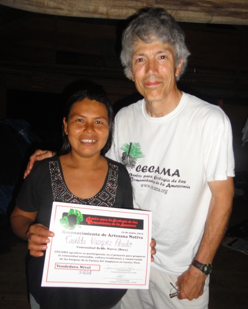 Campbell Plowden and Bora artisan with CACE certificate. Photo by Amrit Moore/Center for Amazon Community Ecology