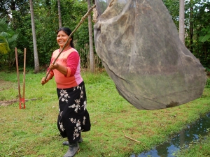 Lucila Flores with butterfly net. Photo by Campbell Plowden/Center for Amazon Community Ecology