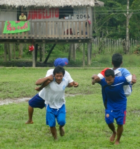 Piggy back race at Brillo Nuevo. Photo by Campbell Plowden/Center for Amazon Community Ecology