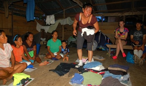 Yully Rojas distributing donated clothes to Bora artisans. Photo by Campbell Plowden/Center for Amazon Community Ecology