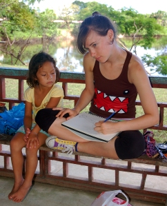 Amrit Moore drawing artisan with girl at Chino. Photo by Campbell Plowden/Center for Amazon Community Ecology