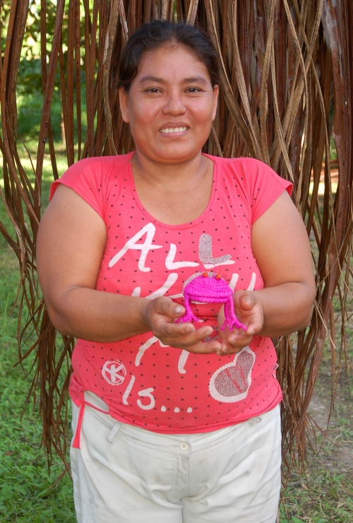 Carmen del Aguila with woven frog. Photo by Campbell Plowden/Center for Amazon Community Ecology