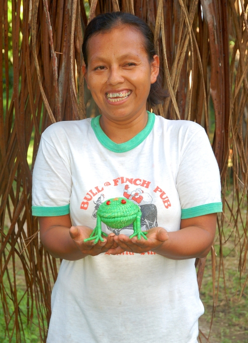 Dalila Lopez with woven frog. Photo by Campbell Plowden/Center for Amazon Community Ecology