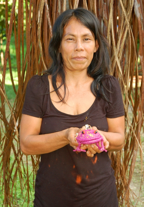 Darli del Aguila with woven frog. Photo by Campbell Plowden/Center for Amazon Community Ecology