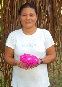 Estelita Loayza with woven frog. Photo by Campbell Plowden/Center for Amazon Community Ecology